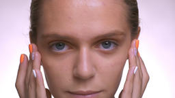 calm look at camera and smooth touch of healthy fresh face by caucasian woman Footage