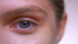 Close-up face and focused blue eye of caucasian female with perfect skin and 영상물