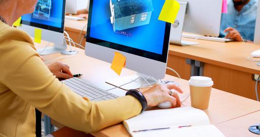 Executive using desktop pc at desk 4k Live Action