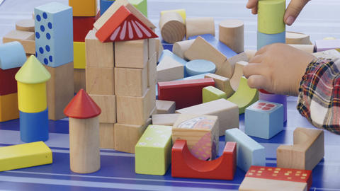 Woman and child play with wooden cubes Footage