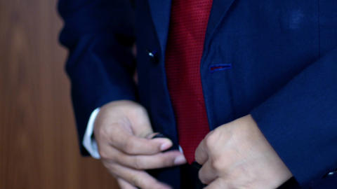4k Close up,Buttoning a jacket. business man in a suit fastening buttons on his Live Action