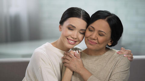 Young and adult women embracing, close relationship of mother and daughter Live Action