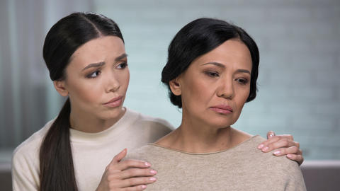 Adult woman feeling loneliness, daughter supporting mother, help of close friend Footage