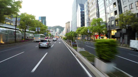 CENTRAL KOBE, JAPAN - Driver POV through the main street along the Flower Road i Footage