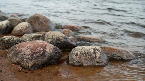Round Boulders On The Riverbank stock footage