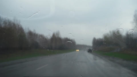 Raindrops on car windshield Footage
