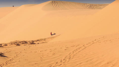 Tourist Tries Draw out Quad from Sand in Sand Dunes Footage