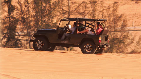 Jeep Does Sand Drag Racing in White Sand Dunes Live Action