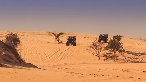 Jeeps Do Sand Drag Racing in White Sand Dunes Live Action