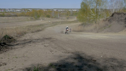 group riders motorcycle rides on dusty track Footage
