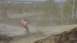 group of motorcyclists jumping off a mountain, dirt road Footage