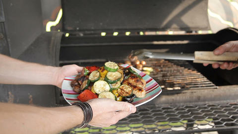 Grilling vegetables on a outdoor barbecue. Vegetables are grilled on charcoal Footage