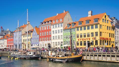 Nyhavn waterfront landmark with crowd of tourist in Copenhagen, Denmark Live Action