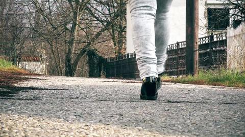 Woman walking on the street Footage