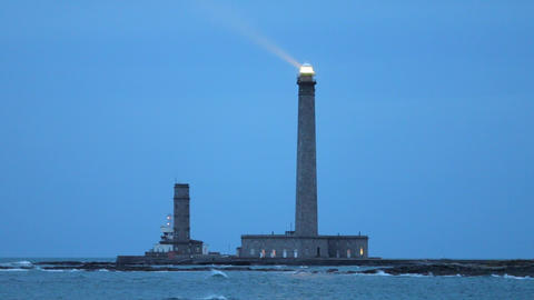 Powerful lighthouse illuminated at dusk Footage