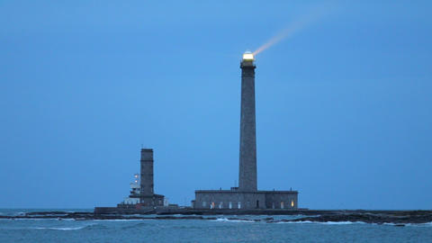 Powerful lighthouse illuminated at dusk Stock Video Footage