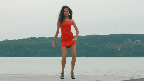 Beautiful woman dancer Kizomba and Bachata outdoors. mixed race woman in red Footage