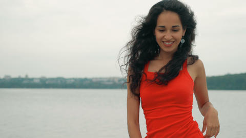 Beautiful woman dancer Kizomba and Bachata outdoors. mixed race woman in red ビデオ