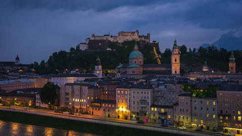 Time lapse video of Salzburg city skyline at night in Austria timelapse 4K Footage