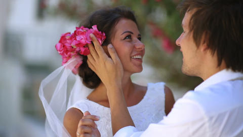 Happy newlyweds on their wedding day. boho style. greece GIF