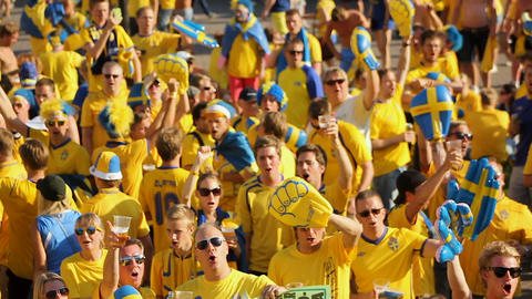 KYIV, UKRAINE - CIRCA JUNE 2012: Football supporters in the city. Crowd of Live Action