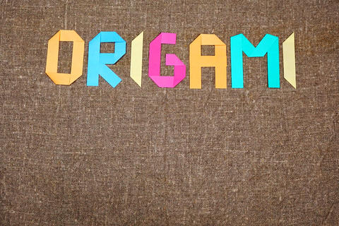 Origami background. Japanese art of paper folding フォト