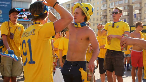 KYIV, UKRAINE - CIRCA JUNE 2012: Football supporters in the city. Cheerful guys Live Action