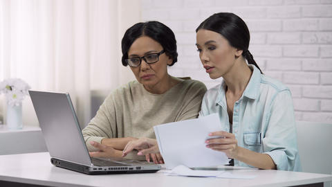 Women use online services, pay for utilities, adult lady learns to write email Live Action