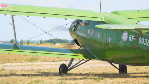 Old biplane aircraft on the runway Live Action