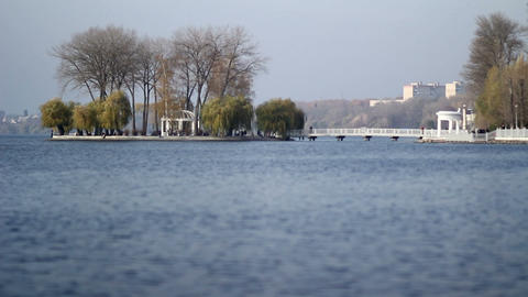 Beautiful view of the lake and city park. The island of lovers on the city lake Footage