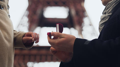 Lover making marriage proposal to his beloved girl on background of Eiffel Tower Footage
