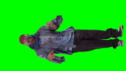 Scary zombie in halloween isolated green background Footage