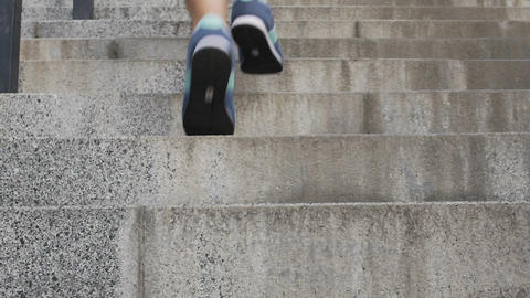 Female running up staircase to achieve goals and dreams, searching for success Live Action