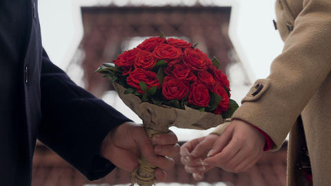 Guy showing his affection to girlfriend, presenting woman with bouquet of roses Live Action
