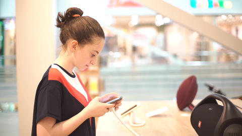 Girl Using Mobile Phone in The Shop Stock Video Footage