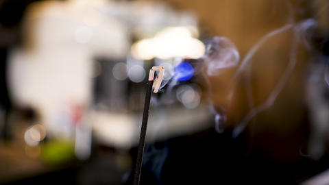 Incense stick burning and spreading the fumes arrounf Stock Video Footage