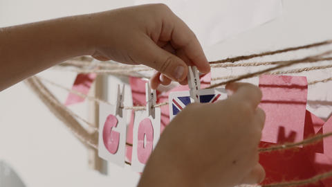 Go word collected by child hand from paper cards Footage