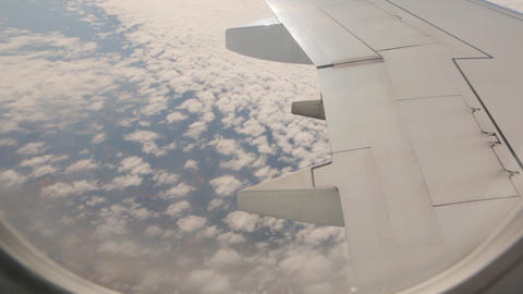 View From Aircraft Above Clouds GIF