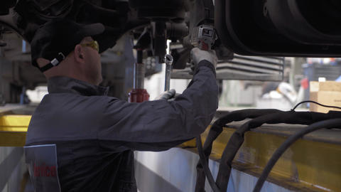 auto mechanic repairs truck suspension GIF