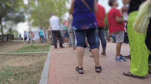 Waiting In Line Outdoors Legs Only Footage