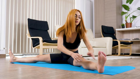 Young fit woman with athletic body in split pose stretching 영상물