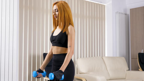 Young woman in living room practicing sport Footage