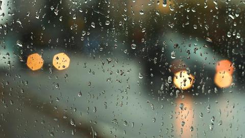 Car lights through wet glass Footage