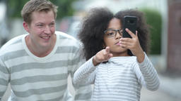 Young cute African girl with Afro hair and young Scandinavian man together in Footage