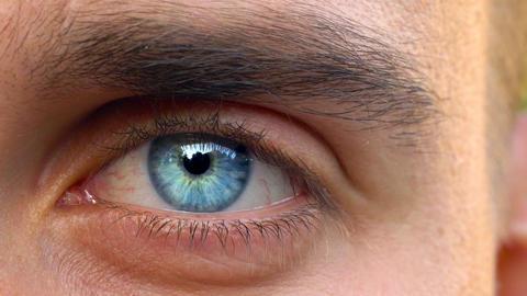 Beautiful blinking male eye close-up Footage