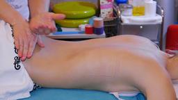 Teenage girl is receiving massage Footage
