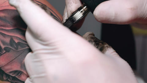 Process of drawing a tattoo on male hand in black ink close-up Footage