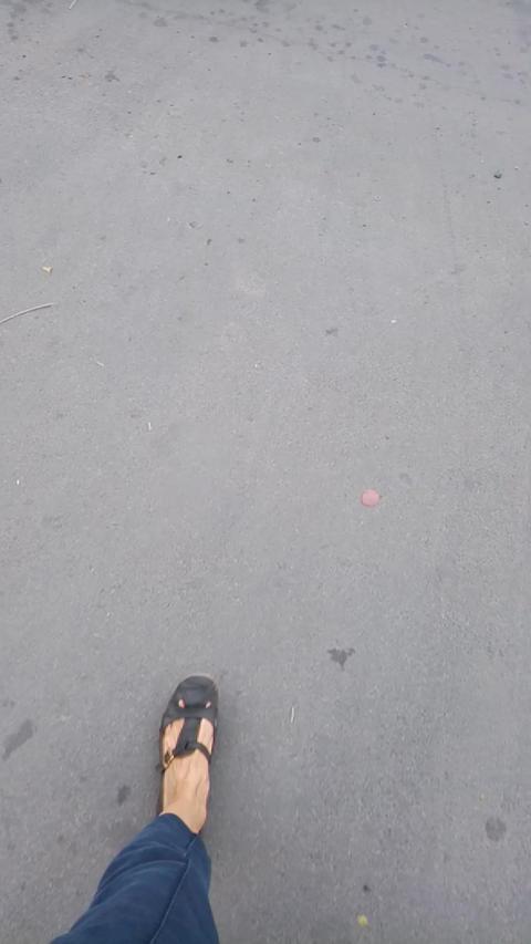 Woman walking along the street Footage