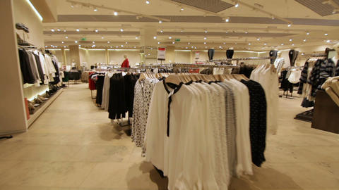 interior of fashion store with business and casual clothes Footage