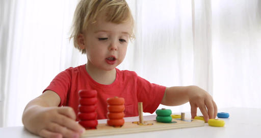 Kid playing with wooden developing puzzle toys Footage